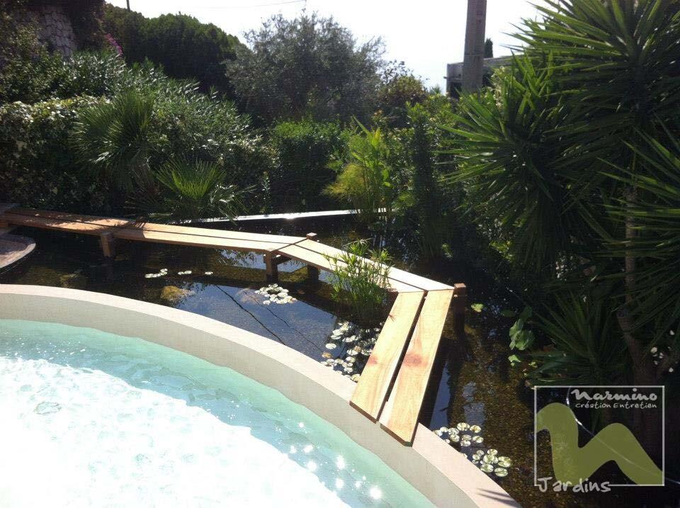 Realisation D Un Bassin Pour Carpes Koi Narmino Jardins