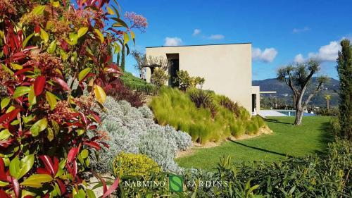 One of the villas and its delicate garden maintained by us